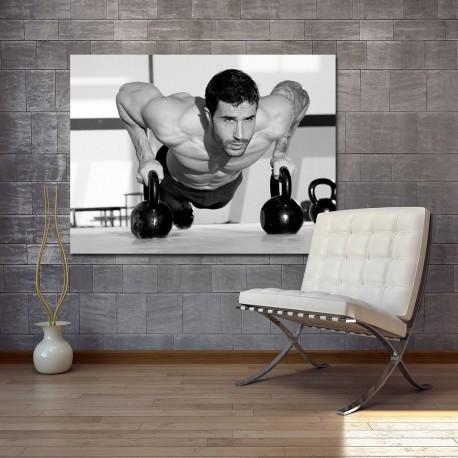 Obraz szklany z motywem ćwiczącego mężczyzny