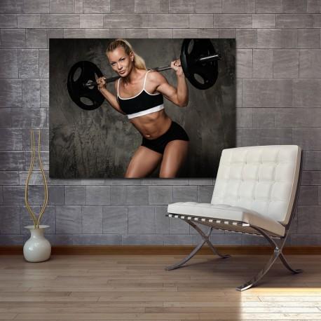 Obraz szklany kobieta na siłowni
